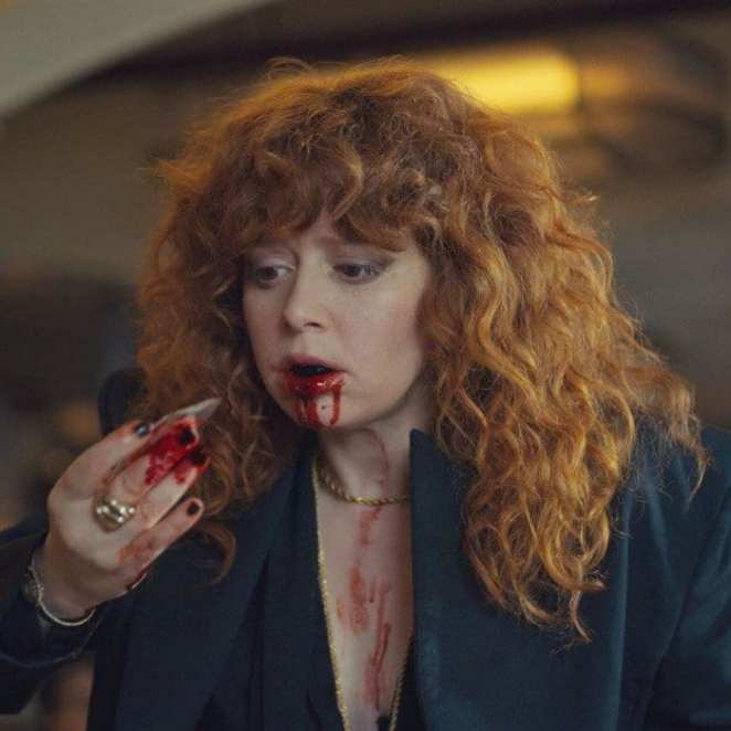 Nadia pulls glass shards from her bloody mouth in Russian Doll.