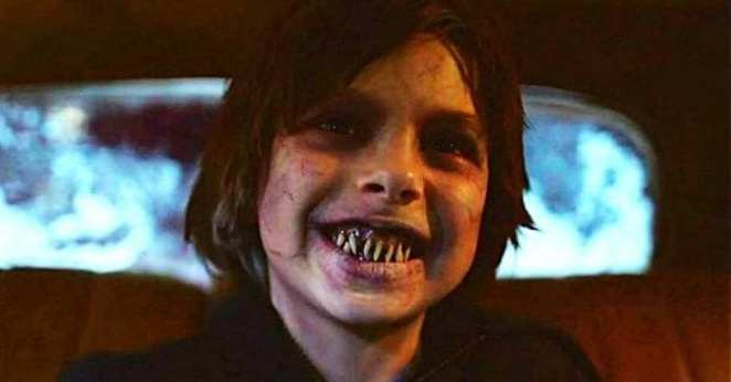 Daniel Moore flashes his new fangs sitting in the Wraith in the NOS4A2 pilot episode
