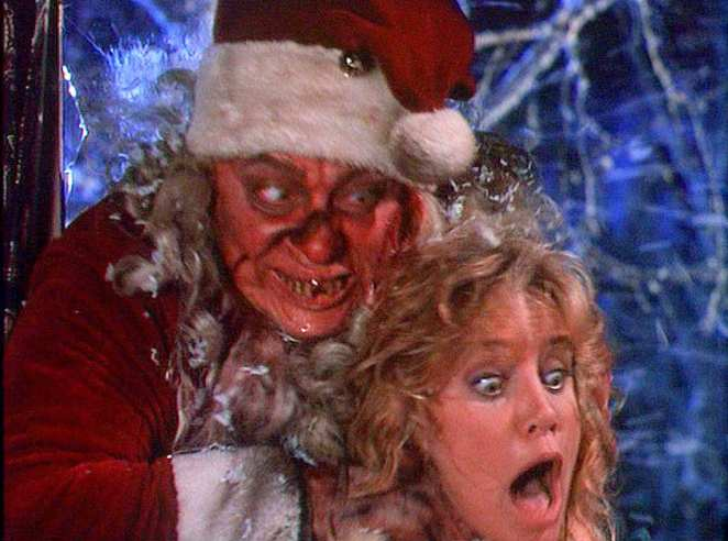 Larry Drake (killer Santa) strangles The Woman (Mary Elizabeth Trainor) in Tales From the Crypt's