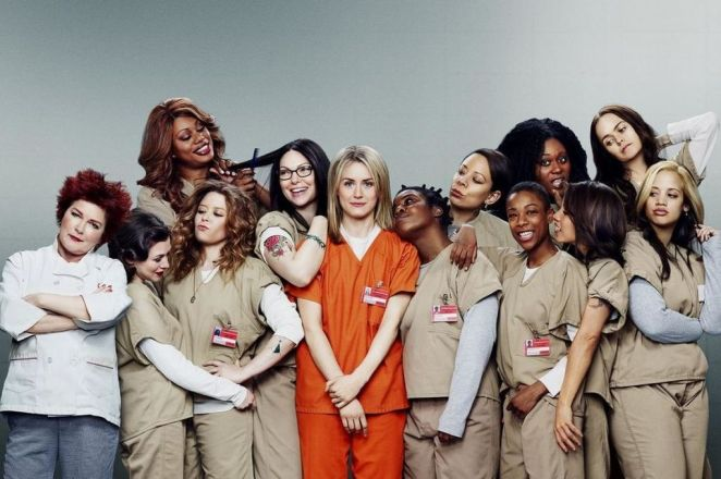 Nicky and Morello surrounded by the main cast of Orange is the New Black