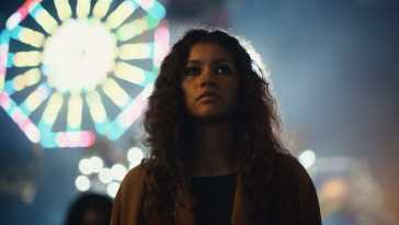 Rue at the carnival with a Ferris wheel in the background in Euphoria