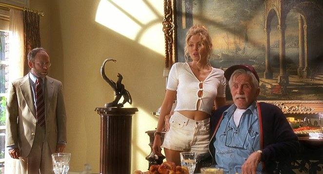 Kirk Douglas an older man introduces his son to his much younger girlfriend, who is wearing tight shorts and top which is revealing
