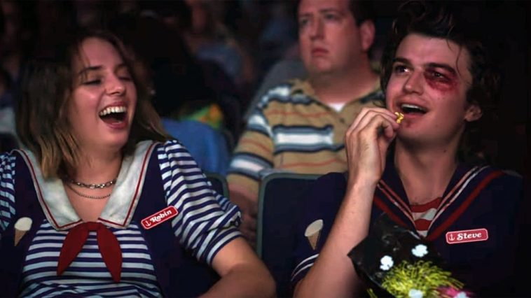 Steve (Joe Keery) and Robin (Maya Hawke) watch a film at the Starcourt Mall.