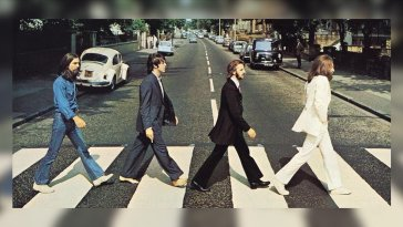 The Beatles George Harrison Paul McCartney Ringo Starr John Lennon walk across the Abbey Road zebra crossing