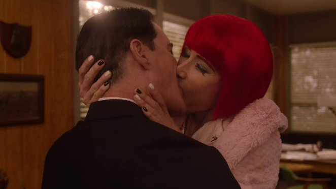 Diane with a bright red bob, kisses Dale Cooper passionately. Her fingernails are black and white