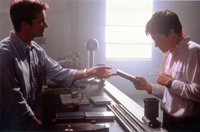Professor Kenneth Monnitoff hands the book The Philosophy of Time Travel to Donnie Darko
