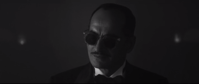 Farouk playing piano in Legion