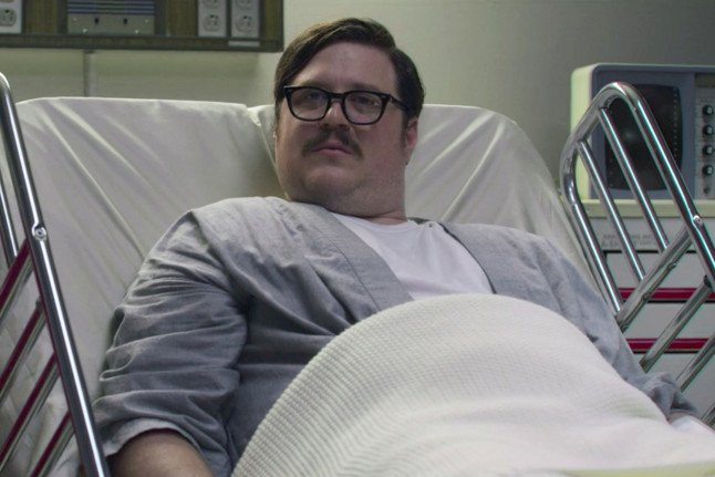 Ed Kemper sits in a hospital bed in Mindhunter