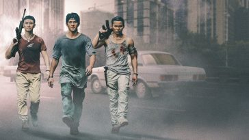 Triple Threat Netflix image of 3 men walking down a dusty street carrying weapons