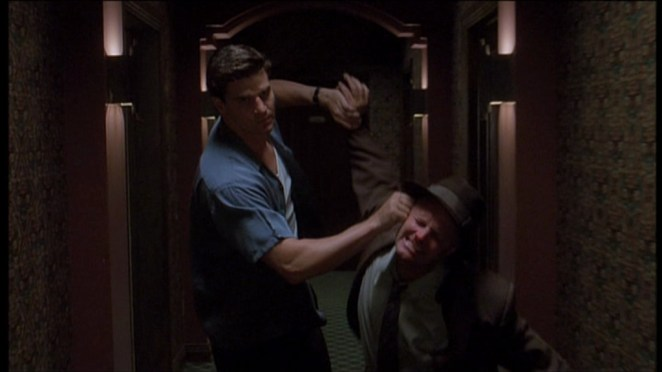 Angel drags the PI down the hallway by his ear