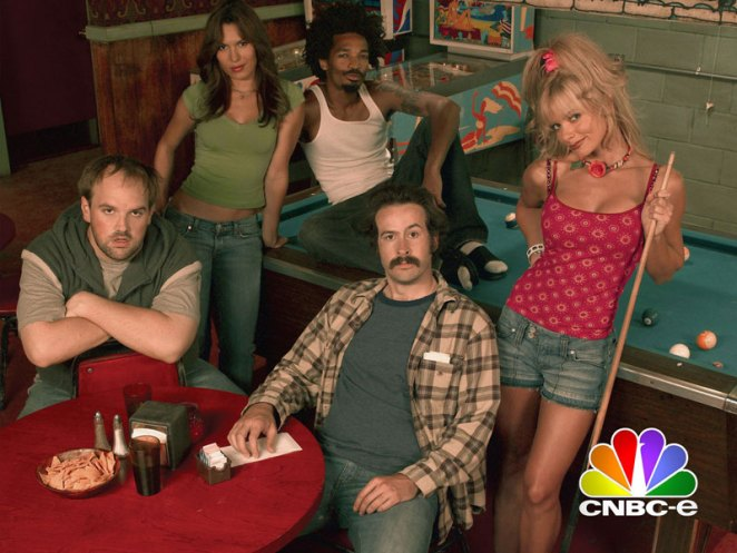 From left to right: Randy, Catalina, Crabman, Earl, and Joy pose at a bar next to a pool table
