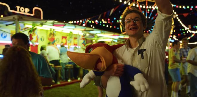 At the fair, Alexei holds a Woody Woodpecker toy and waves