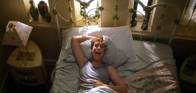 Laurie Strode screams herself awake in bed after having another nightmare about Michael Myers