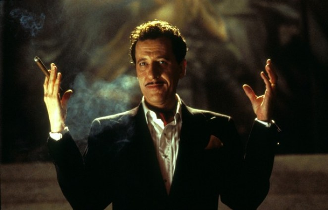 Stephen Price raises his hands to welcome his party guests to the House on Haunted Hill.