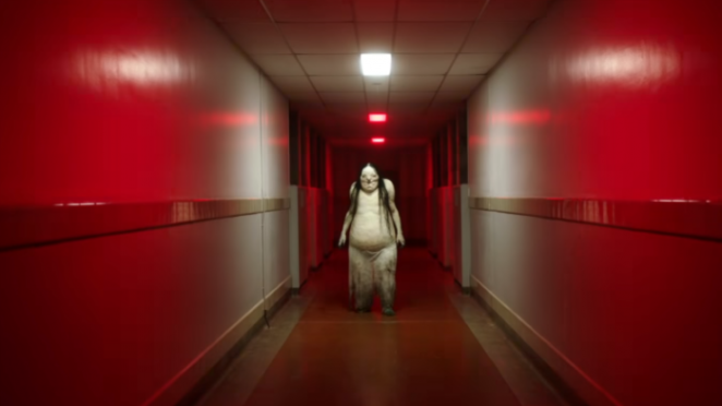 pale lady creature in the hallway