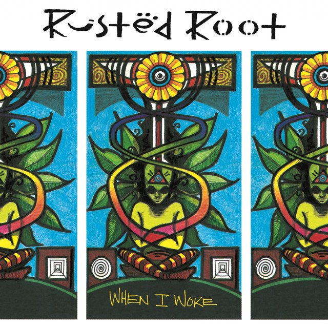 When I Woke album cover is a painting of a man with energy flowing through a plant behind him up to the yellow flowerlike sphere at the top near the name Rusted Root.