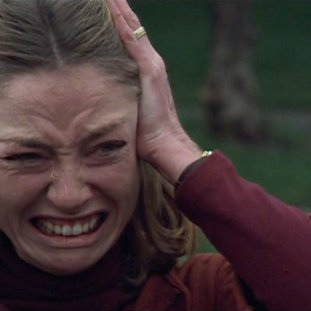 Veronica Cartwright as Nancy, holding her head and crying in despair