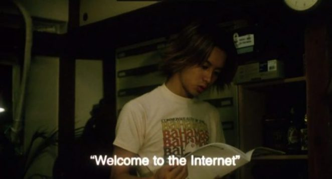 A Japanese man holds a book about the Internet in Pulse
