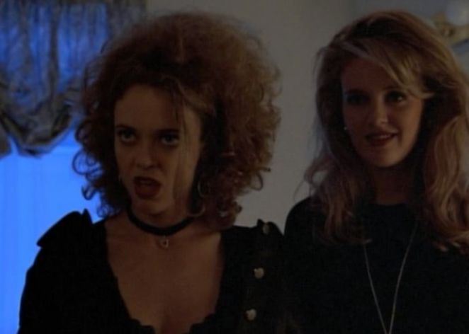 Terri and Margi standing together in gothic/punk clothing, looking flippant and confident.