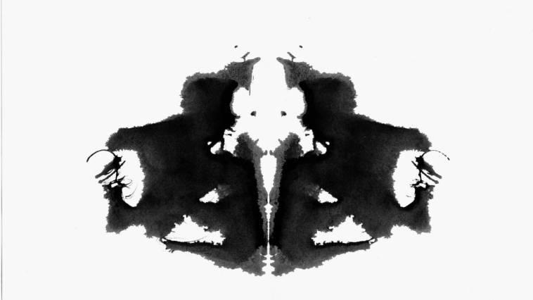 A Rorschach test ink blot on a white background.
