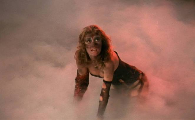 Covered in dirt, Janet crawls through the smoke.