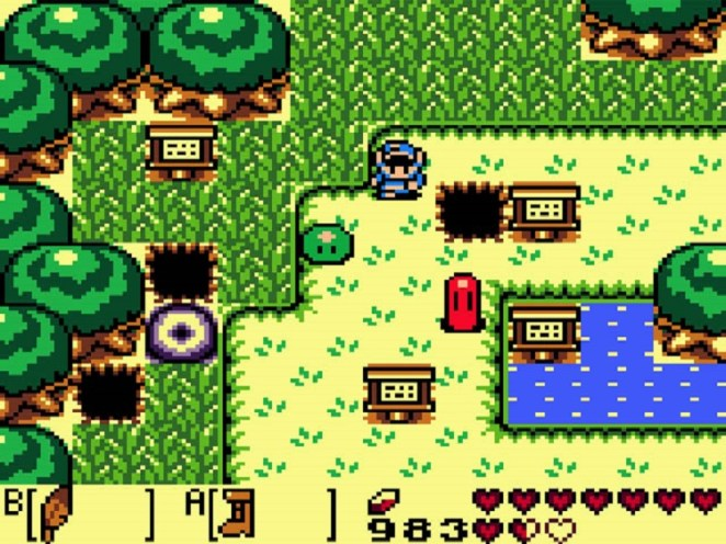 Link stands in a field with a few signs as well as a green slime and a pink slime