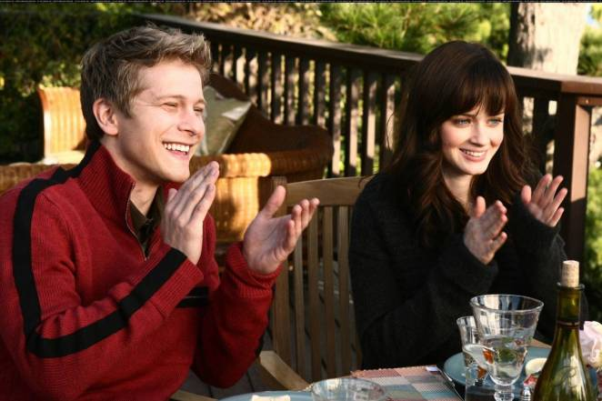 Logan and Rory sitting at a dining table clapping