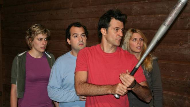 The friends stand outside their cabin, Matt armed with a baseball bat