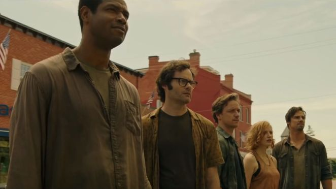 The five now grown up kids from IT Chapter one stand on a street.