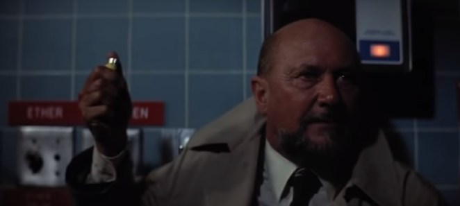 Dr Loomis sparks the lighter in a room full of explosive gases.