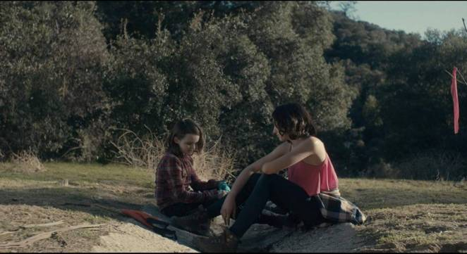 Tate Birchmore, and Nicole Moorea Sherman chat in the woods in Between the Darkness (2019)