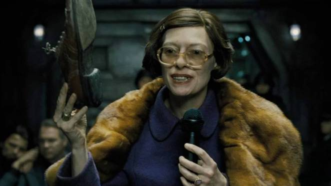Mason (Tilda Swinton) holds up a worn shoe in an attempt to explain the different classes on the Snowpiercer