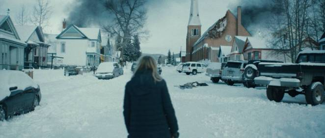 Aubrey stares down the vacant and ravaged streets of her snowy hometown.