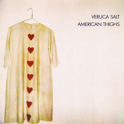The album cover to Veruca Salt's American Thighs is a stark purple that is almost white, and a shirt hanging from a hanger on the left side. The white shirt has 7 red hearts on it, spaced straght down from the neck to the bottom.