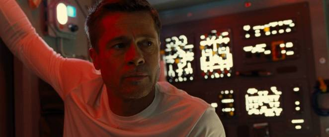 Roy McBride (Brad Pitt) listens intently for his latest orders aboard a rocket ship.