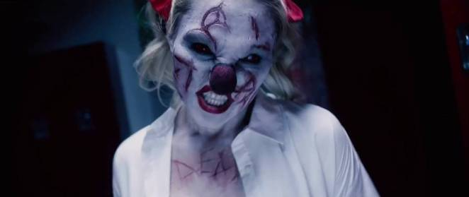 Dead female clown with scars saying dead on her chest in Bedeviled