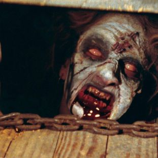a woman under the floorboards with a demonic face