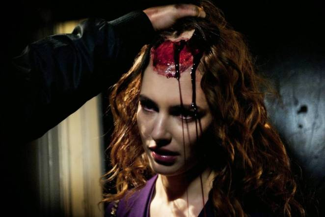Frank slowly pulls the scalp from on of his victims, a beautiful young girl, revealing the gore beneath
