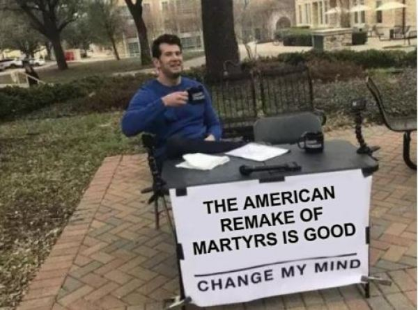 Steven Crowder sits at a table with a banner that says the American remake of Martyrs is good