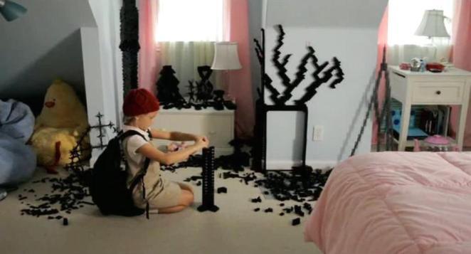 Abigail builds black lego sculptures in her bedroom