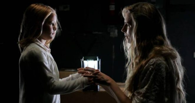 Abigail and Maggie meet and complete the secret handshake