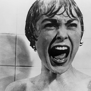 a woman screams with terror in the shower