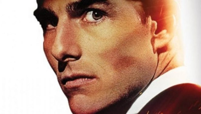 Tom Cruise as Hunt looking into lens