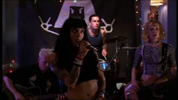 Bif Naked perform at a party.