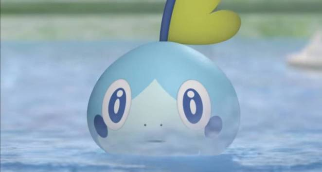 Sobble emerges from the water.