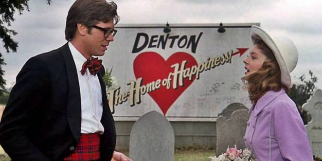 Brad and Janet get engaged in front of the Denton sign