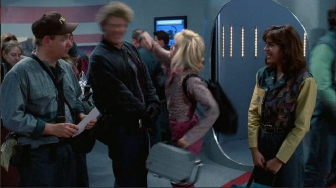 Barbara Crampton punches a man in the face in Robot Wars