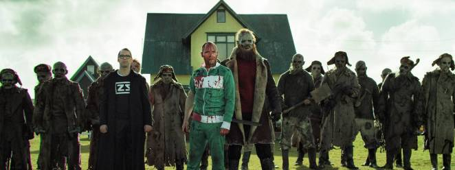 Two blood-stained men stand with a horde of Russian POW zombies in Dead Snow 2: Red vs. Dead.