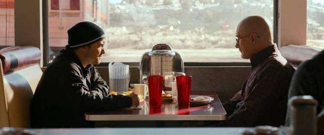 Walt and Jesse sit in a diner booth eating breakfast