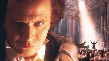 Gary Oldman in foreground as Beethoven in Immortal Beloved; in the background, he conducts a concert